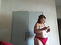 My plump wife feels comfortable dressing up in front of a camera