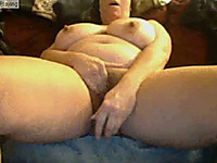 Busty white milf on webcam pummels herself with a dildo