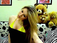 Silly and cute blonde babe in her room full of stuffed toys