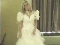 Blonde in wedding dress sucks a cock and fingers her pussy
