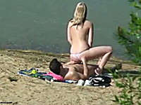 Amateur couple bang in the cowgirl position on a beach
