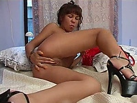 Tanned babe in high heels masturbates with great joy