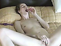 Skinny white wife pleases herself in bed in her favorite style