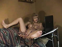 Mature blonde wife dildoes herself on the couch for cam