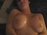 Busty brunette chick with cute smile covered with cum after handjob