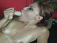Cock hungry brunette chick with plump lips sucks a dildo