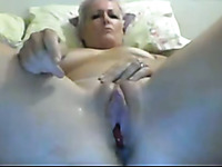 Webcam solo video with a mature blonde toying her cunt