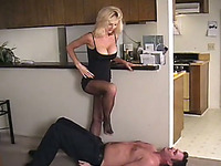 Busty lady gets her feet in fishnets worshiped by her submissive guy