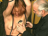 Short haired redhead sweetie is suspended and toyed