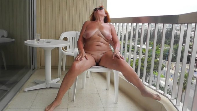 Wife naked on balcony