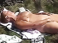 My mature wife pleases herself with fingering outdoors