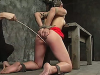 Gagged short-haired bitch enjoys a lot of tortures in BDSM clip