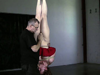 Helpless slave gives head while hanging upside down