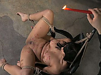 Sweet Asian beauty with tanned skin is tortured with wax
