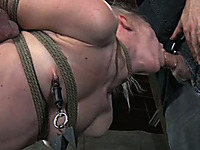 Tattooed blonde sweetie suspended with ropes deep throats master's dick