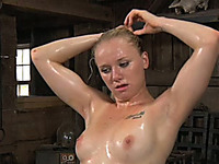 Gorgeous blonde bitch with oiled body obeys her master