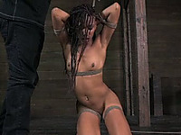 Small titted ebony slave girl tied with ropes is beaten by her master
