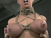 Boobylicious blonde chick bounded with ropes and a gag examined by her master