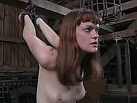 Sexy redhead bitch bounded in the cage needs to be punished