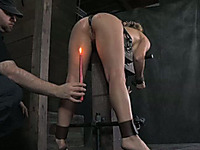 Sexy brunette bitch wearing iron mask sucks a dildo and gets it in her snatch