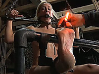 Dissolute blonde beauty with mind blowing body has burning candle between her toes
