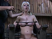 Pigtailed blonde slave with ring gag in her mouth gets her snatch ruined with toys