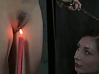 Brunette chick with sexy body is tortured with candle light