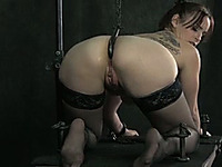 Lustful girl with a hook in her ass bounded by sexy mistress
