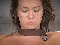 Sexy girl with collar on her neck gives interview after tortures