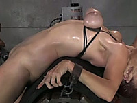 Bounded milf with oiled body is tortured by two mentors
