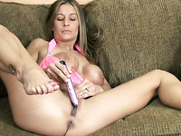 Fake-boobed blonde mom satisfies herself with the help of a dildo