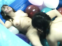 Two horny lesbians lick and toy pussies among balloons