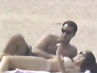 Hidden cam scene with a couple making love on a beach