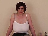 Short haired ugly amateur brunette plays with her huge oiled boobies