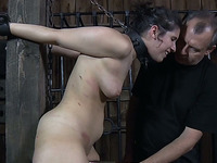Brunette white cutie starts sweating during BDSM session