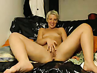 Playful milf double penetrates herself with sex toys