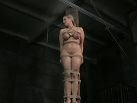 Big breasted oiled blonde MILF stands on toes while being tied up hard