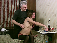 Slender dark haired chick with natural tits lazily jerks off old cock
