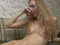 Light haired slender amateur nympho flashes her tits and ass on sofa