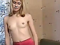 Blonde chick Nastya exposes her pussy and pisses right on the couch