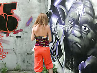 Redhead Russian chick pees in her orange pants on the bridge