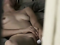 I spy on my blond haired wifey petting her inviting pussy with dildo