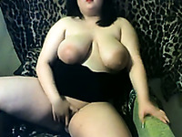 Chubby brunette milf shows her private parts and fingers her cunt