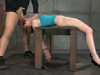 Fixed lying on the wooden table redhead gets mouthfucked rather rough