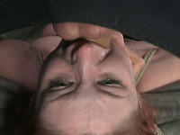 Gagged redhead gets tied up and teased in BDSM mode by her master