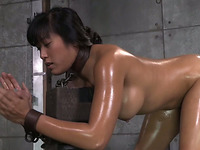 Submissive Filipina brunette with nice rack is oiled and fucked hard
