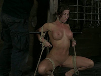 Wet cunt of tied up busty brunette MILF is teased with huge vibrator