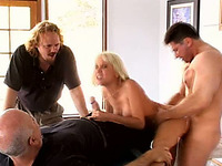 Curvaceous and busty blondie Sandy fucked by friends of her hubby