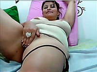 Webcam clip with juicy-assed Latina fingering her pussy