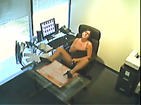 Hidden cam catches a woman masturbating at her work place